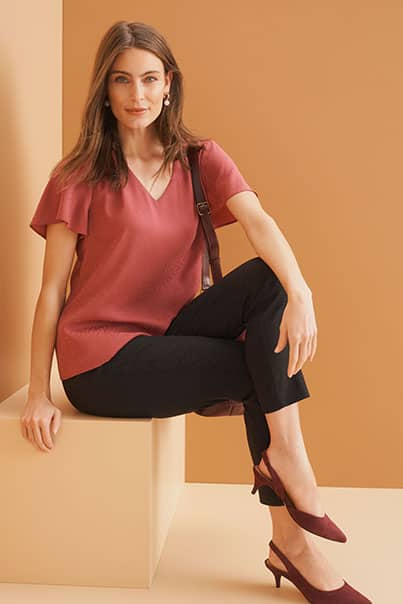 Woman in red blouse and black pants