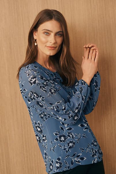 Woman in blue print blouse