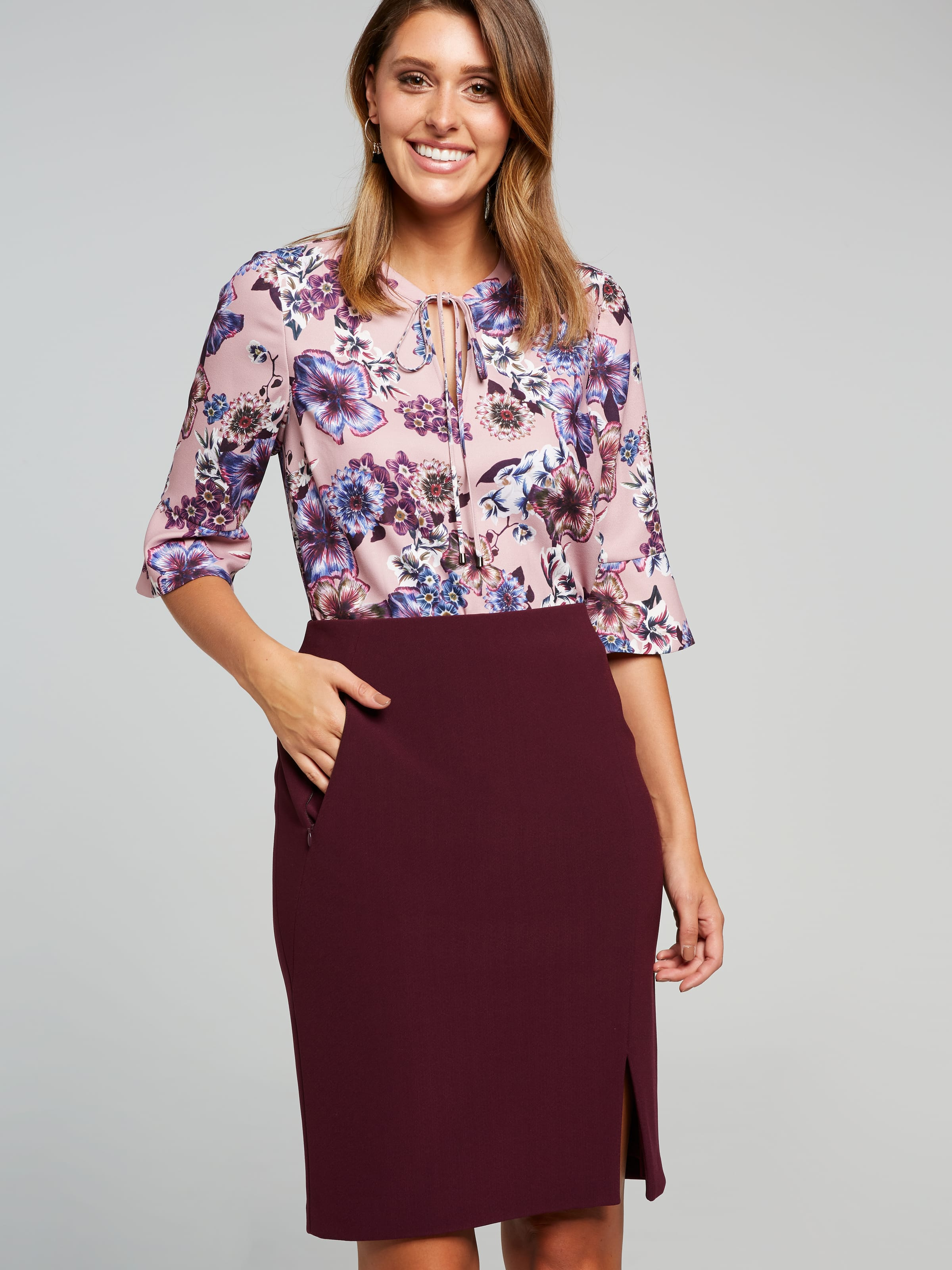 This Rosie Stretch Pencil Skirt Is Made In A Polyester/Elastane Blend Stretch Fabrication For The Ultimate Fit And Comfort. Finishing At The Knee In Length, This Is Your Perfect Work Skirt. Team It Together With A White Blouse And A Pair Of Black Heels.(Plum, 12)