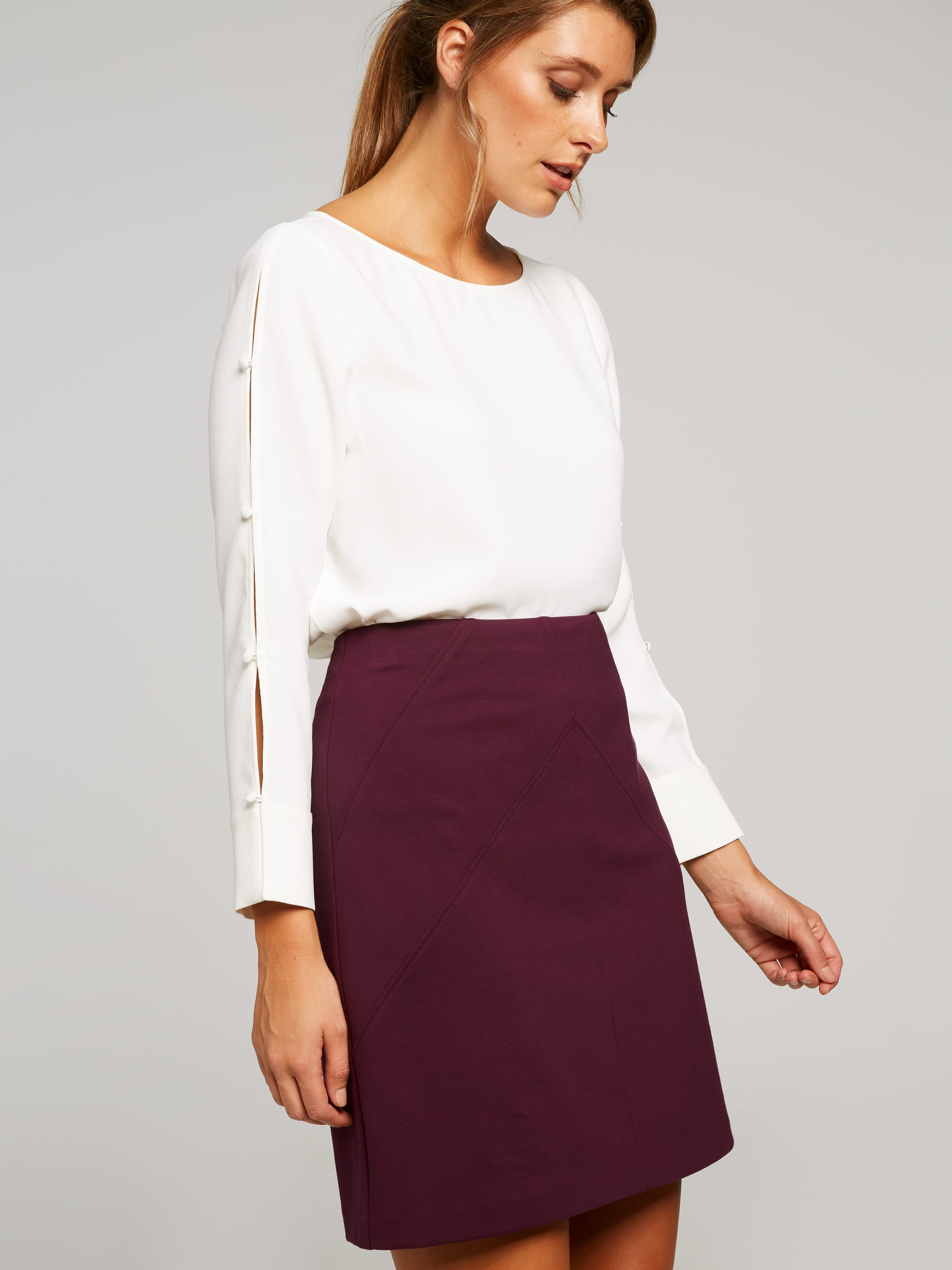 Part Of Our Core Ponte Range, This Slim Fitting Skirt Will Hug In You In All The Right Places. Stretchy Fabrication. Centre And Diagonal Seamfront. Zip Up Back. Easy To Pull On. Wear With Any Of Our Fashionable Tops To Take Youout From Work To Dinner.(Essential Plum, 6)