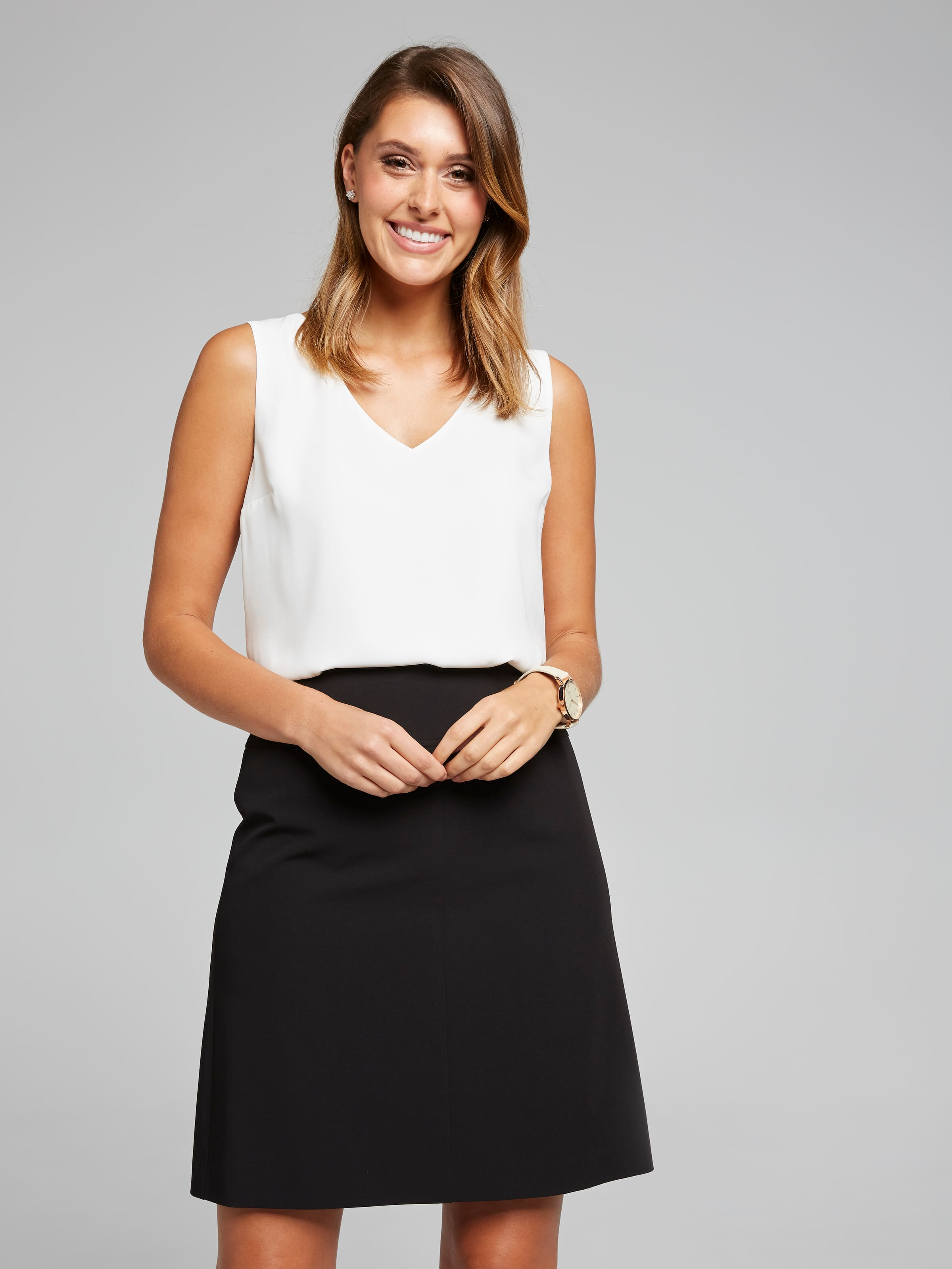 Always a staple in any working women's wardrobe. In a flattering A-Line siluette, wear back with our matching range of suiting or mix and match for a creative twist.(Black, 12)