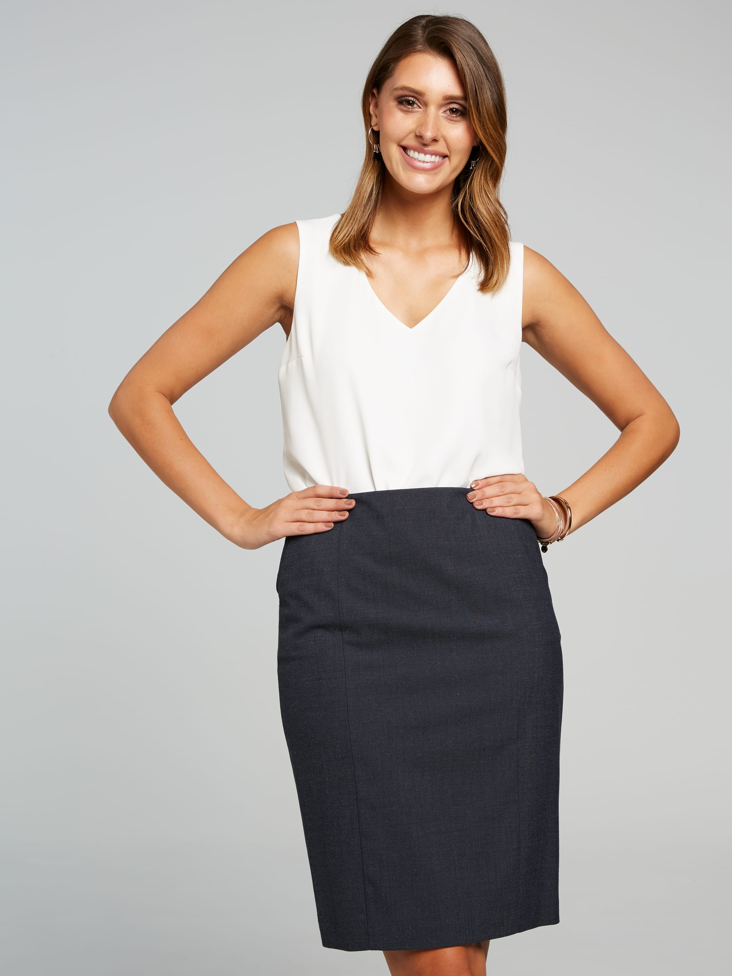 Our Classic Knee Length Skirt Features Tailored Panels On Front And Back. Considered Details Include Button Tab Detail At Waist To Coordinate With The Matching Jacket And Pant. Centre Back Zip Closure, And Vent At Back Hem For Ease Of Movement.(Storm, 16)