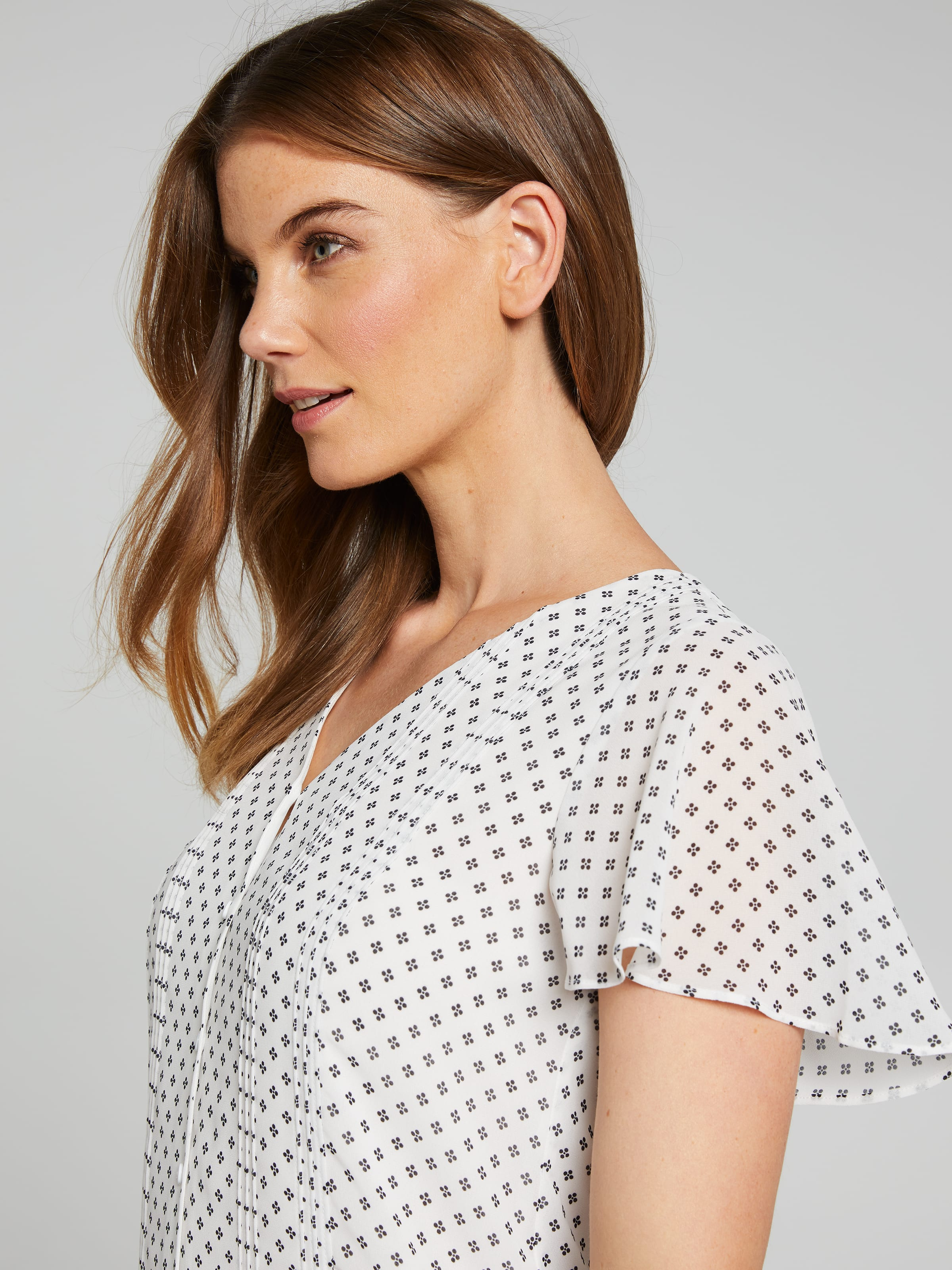 Amelia Flutter Button Blouse